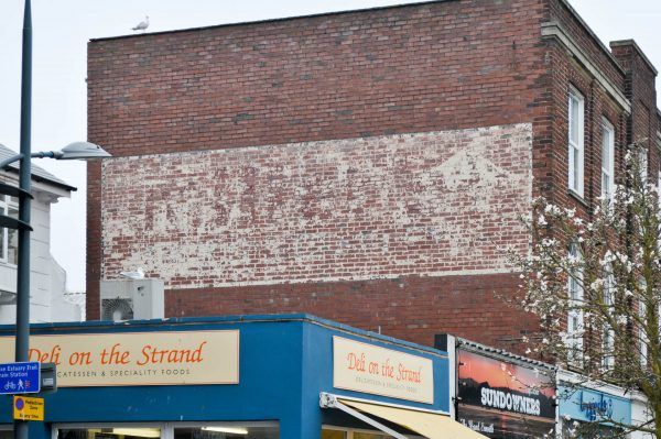 Ghost sign facing the Strand Exmouth